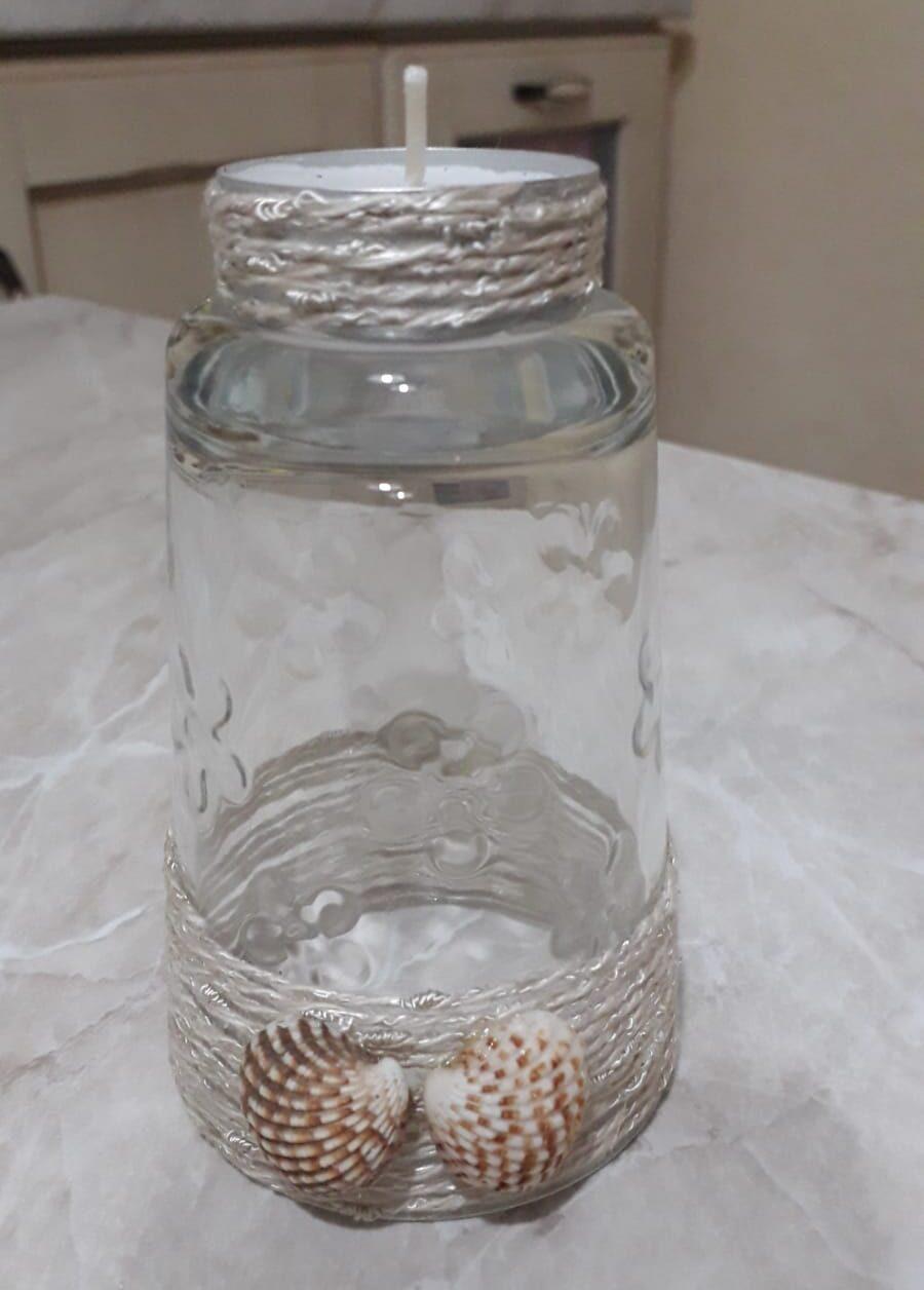 bicchiere a candela con conchiglie